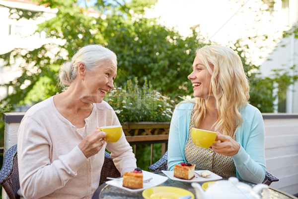 daughter with senior mother drinking tea at cafe Stock photo © dolgachov