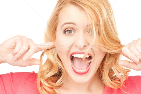 woman with fingers in ears Stock photo © dolgachov