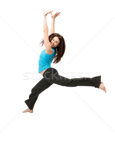 Skoki dziewczyna jasne zdjęcie szczęśliwy Zdjęcia stock © dolgachov