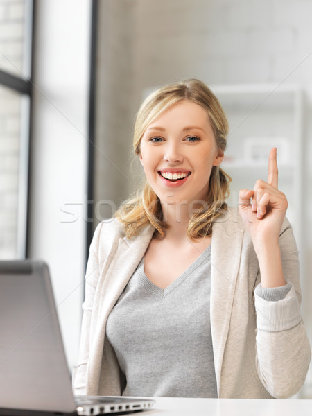 woman with laptop and finger up Stock photo © dolgachov