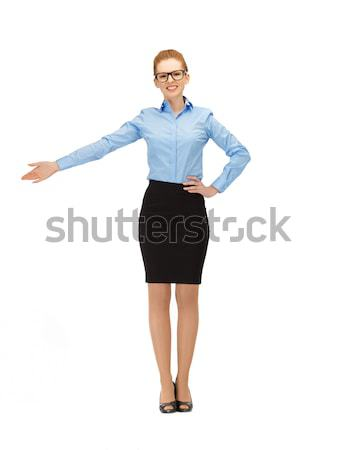attractive businesswoman pointing her hand Stock photo © dolgachov