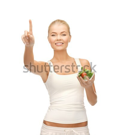 Gezonde vrouw kom salade wijzend Stockfoto © dolgachov