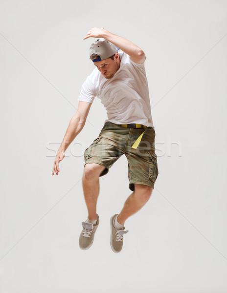 Férfi táncos ugrik levegő kép férfi Stock fotó © dolgachov