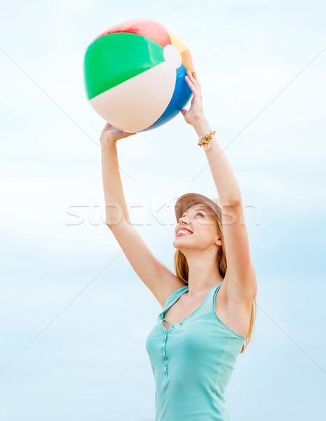 girl playing ball on the beach Stock photo © dolgachov