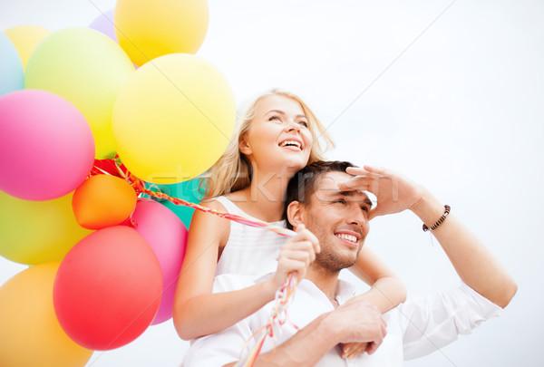 Casal colorido balões beira-mar verão férias Foto stock © dolgachov