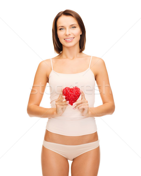 beautiful woman in cotton underwear and red heart Stock photo © dolgachov