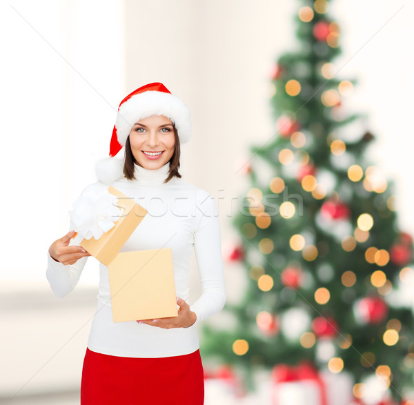 smiling woman in santa helper hat with gift box Stock photo © dolgachov