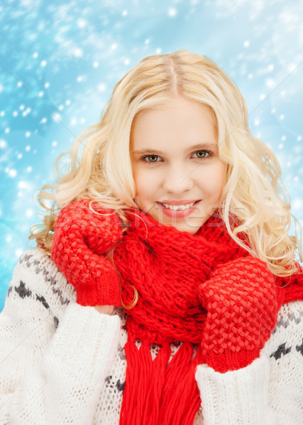 smiling teenage girl in red mittens and scarf Stock photo © dolgachov