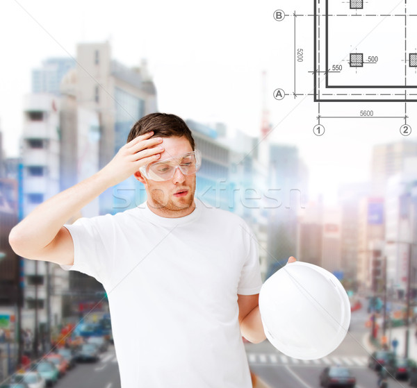 Stock photo: male architect in safety glasses taking off helmet