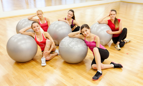 smiling people working out in pilates class Stock photo © dolgachov