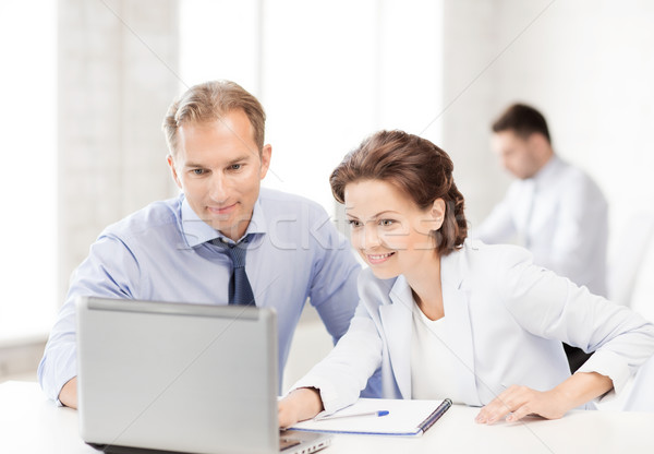 man and woman working with laptop in office Stock photo © dolgachov