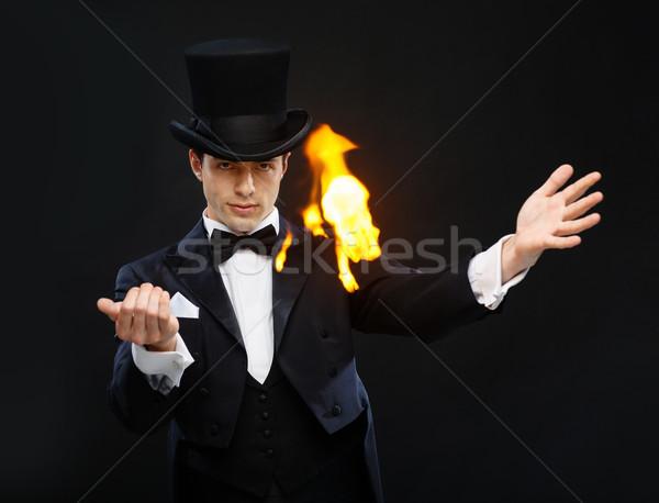 Bűvész felső kalap mutat trükk tűz Stock fotó © dolgachov