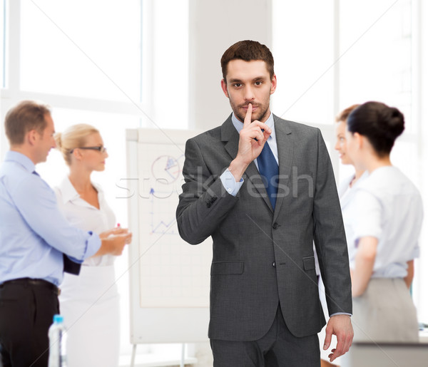 group of businessmen making hush sign Stock photo © dolgachov