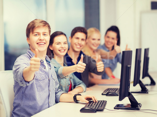 students with computer monitor showing thumbs up Stock photo © dolgachov