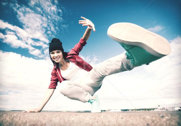 beautiful dancing girl in movement Stock photo © dolgachov