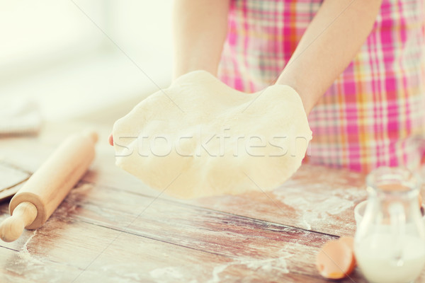 close up of female hands holding bread dough Stock photo © dolgachov