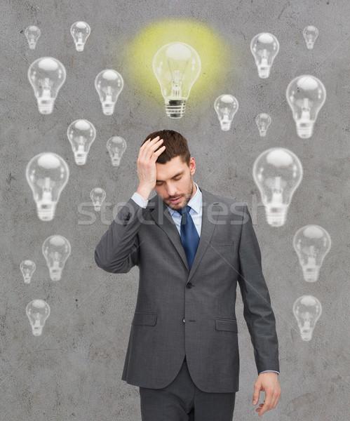 handsome businessman having problems Stock photo © dolgachov