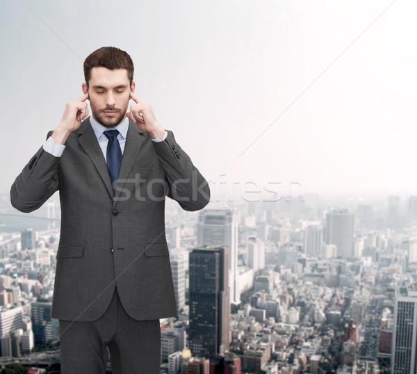 Infastidito imprenditore orecchie mani ufficio istruzione Foto d'archivio © dolgachov