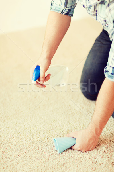 close up of male cleaning stain on carpet Stock photo © dolgachov
