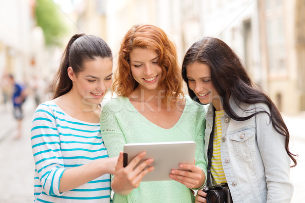 smiling teenage girls with tablet pc and camera Stock photo © dolgachov