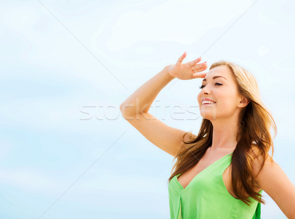 girl looking for direction on the beach Stock photo © dolgachov
