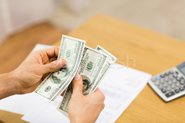 close up of man hands counting money at home Stock photo © dolgachov