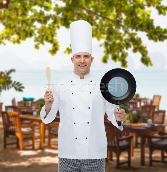Heureux Homme chef poêle spatule Photo stock © dolgachov