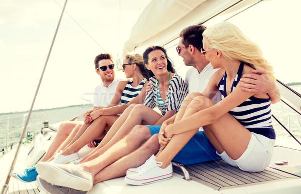Mosolyog barátok ül jacht fedélzet vakáció Stock fotó © dolgachov