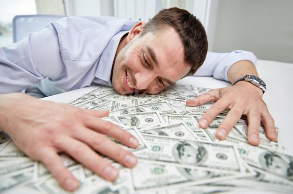 Boldog üzletember halom pénz iroda üzletemberek Stock fotó © dolgachov