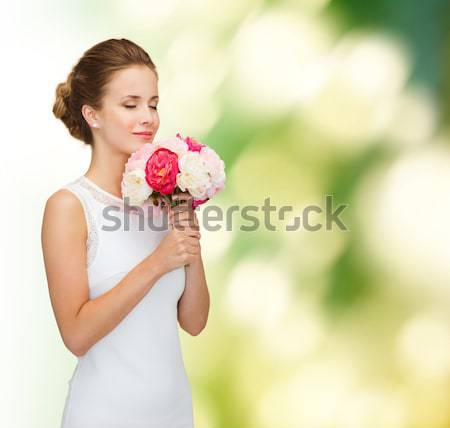 woman with bouquet of flowers Stock photo © dolgachov
