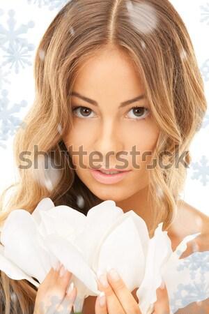beautiful woman with white flower Stock photo © dolgachov