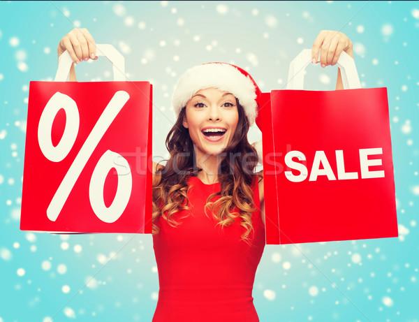 女性 赤いドレス ショッピングバッグ ショッピング 販売 贈り物 ストックフォト © dolgachov