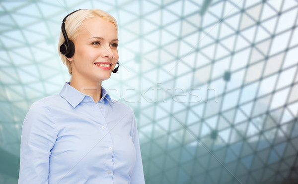 helpline operator in headset over grid background Stock photo © dolgachov
