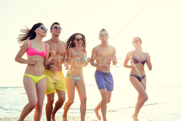 笑みを浮かべて 友達 サングラス を実行して ビーチ 友情 ストックフォト © dolgachov