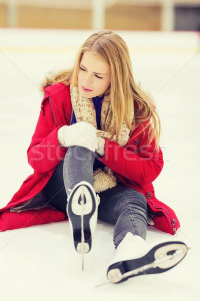 young woman fell down on skating rink Stock photo © dolgachov