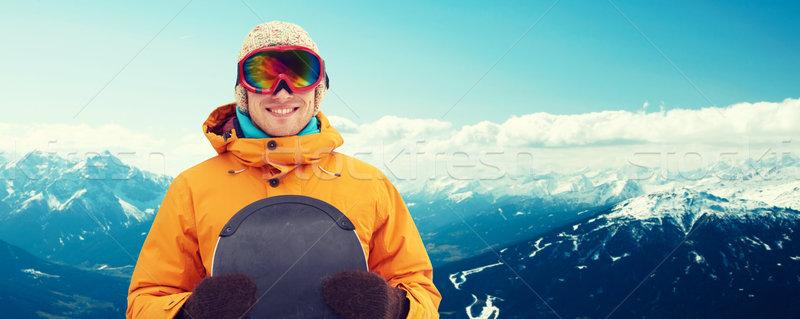 Boldog fiatalember síszemüveg hegyek tél szabadidő Stock fotó © dolgachov