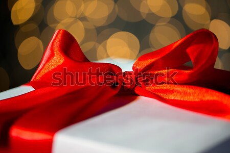 close up of christmas gift with bow over lights Stock photo © dolgachov