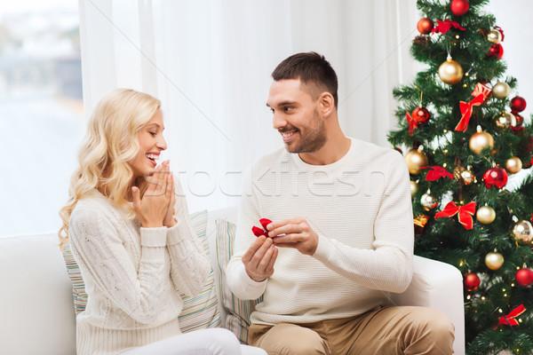 man giving woman engagement ring for christmas Stock photo © dolgachov