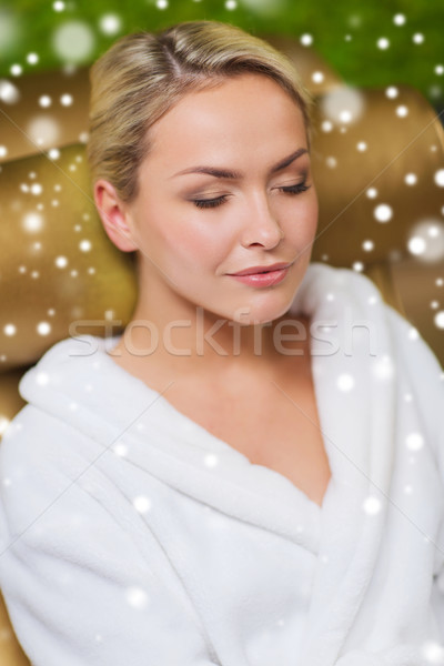 close up of woman sitting in bath robe at spa Stock photo © dolgachov
