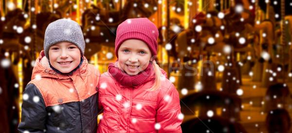 Kislány ölel fiú hó körhinta gyermekkor Stock fotó © dolgachov