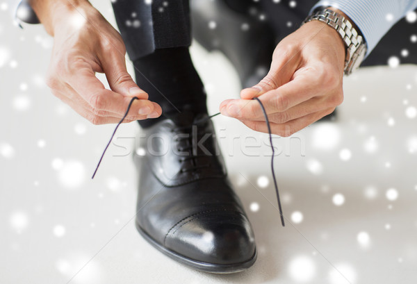 close up of man leg and hands tying shoe lace Stock photo © dolgachov