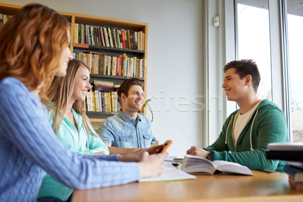 students with books preparing to exam in library Stock photo © dolgachov