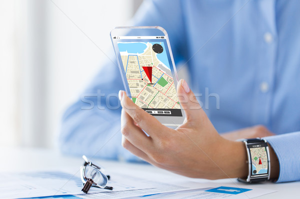 hand with navigator map on smart phone and watch Stock photo © dolgachov