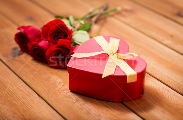 close up of heart shaped gift box and red roses Stock photo © dolgachov