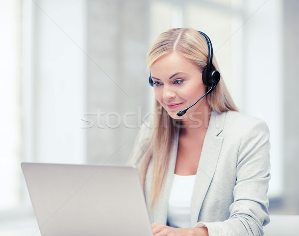 friendly female helpline operator Stock photo © dolgachov