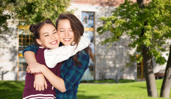 Feliz sonriendo bastante estudiante ninas Foto stock © dolgachov