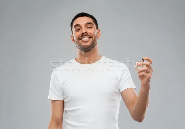Uśmiechnięty człowiek mężczyzna perfum szary perfumeria Zdjęcia stock © dolgachov
