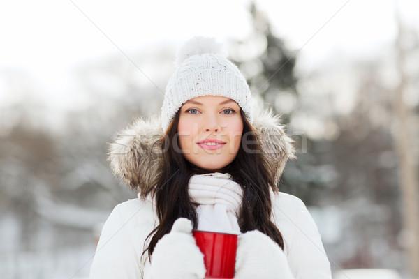 Boldog fiatal nő teáscsésze kint tél emberek Stock fotó © dolgachov