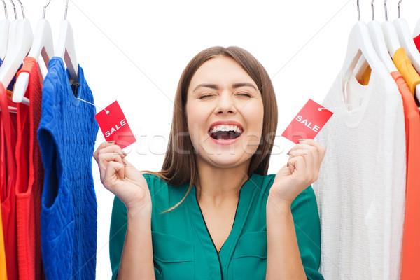 Boldog nő vásár címkék ruházat ruhásszekrény Stock fotó © dolgachov