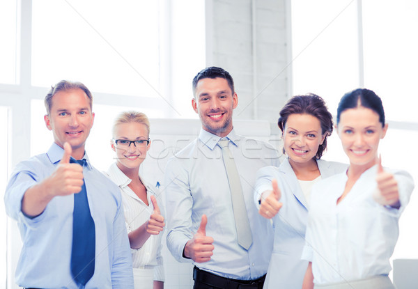 business team showing thumbs up in office Stock photo © dolgachov